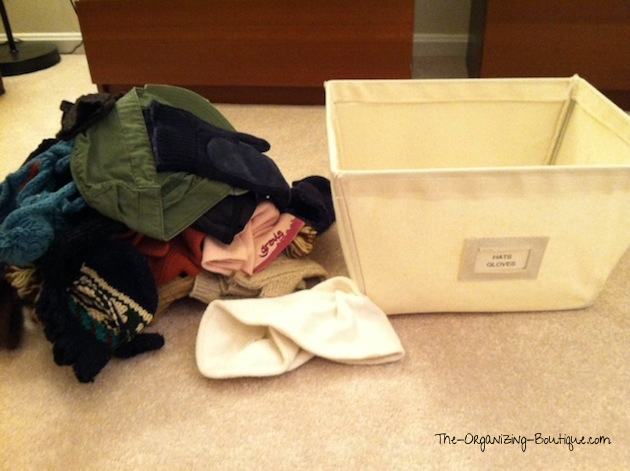 organize hats and gloves in home storage bins