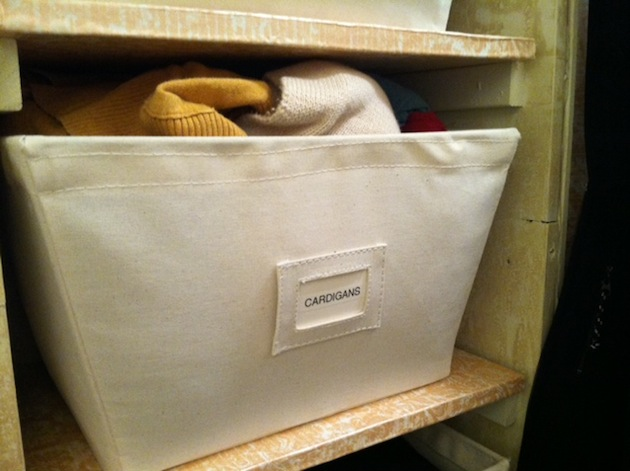 organize cardigans for women & men in open canvas storage bins