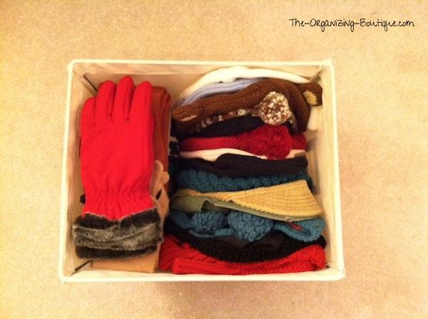 organize hat and gloves in home storage bins